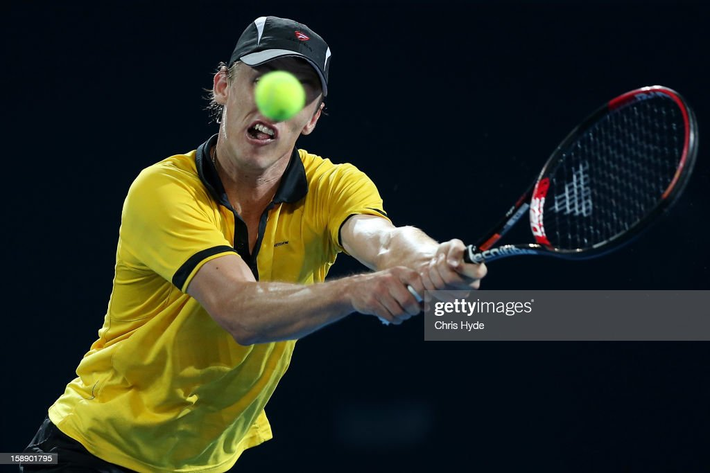 John Millman of Australia plays a backhand during his match against Andy Murray of Great Britain on during day five of the Brisbane International at Pat Rafter Arena on January 3, 2013 in Brisbane, Australia.