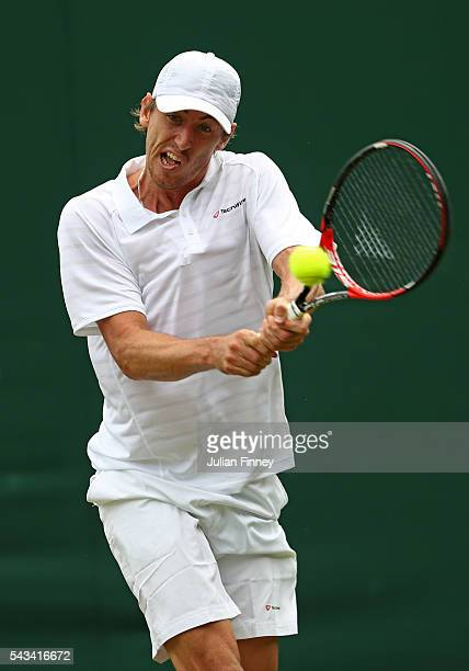 John Millman of Australia plays a backhand during the Men's Singles first round match against Albert Montanes of Spain on day two of the Wimbledon...