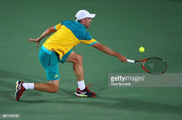 John Millman of Australia plays a backhand during the Men's Singles second round match against Kei Nishikori of Japan on Day 3 of the Rio 2016...