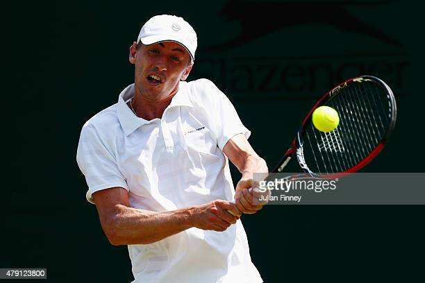 John Millman of Australia plays a backhand in his Gentlemens Singles Second Round match against Marcos Baghdatis of Cyprus during day three of the...