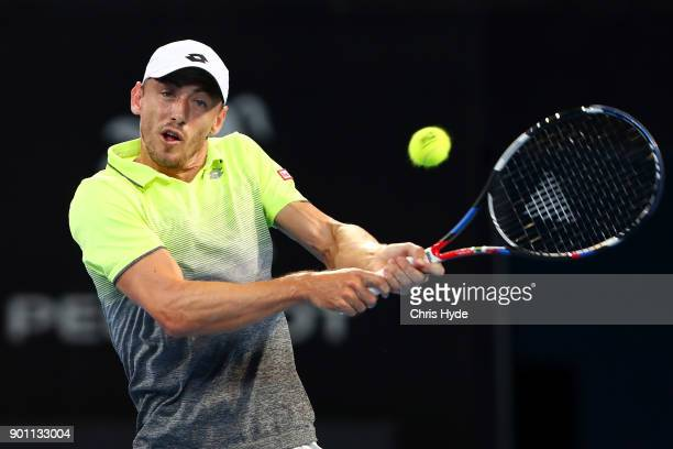 John Millman of Australia plays a backhand in his match against Grigor Dimitrov of Bulgaria during day five of the 2018 Brisbane International at Pat...