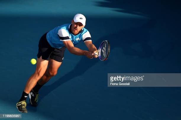 John Millman of Australia plays a backhand shot against Benoit Paire of France during day four of the 2020 ASB Classic at ASB Tennis Centre on...