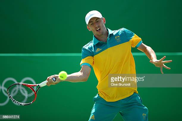 John Millman of Australia plays a forehand against Ricardas Berankis of Lithuania in their first round match on Day 1 of the Rio 2016 Olympic Games...