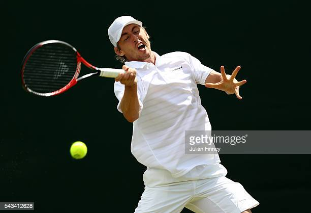 John Millman of Australia plays a forehand during the Men's Singles first round match against Albert Montanes of Spain on day two of the Wimbledon...