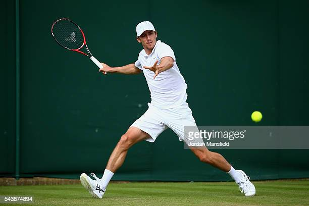 John Millman of Australia plays a forehand during the Men's Singles second round match against Benoit Pare of France on day four of the Wimbledon...