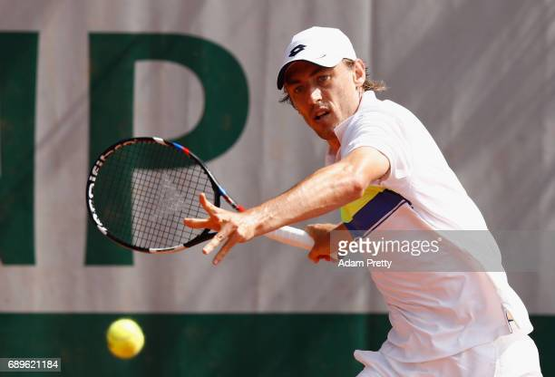 John Millman of Australia plays a forehand during the mens singles first round match against Roberto Bautista Agut of Spain on day two of the 2017...