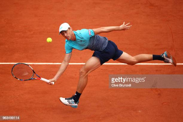 John Millman of Australia plays a forehand during the mens singles first round match against Denis Shapovalov of Canada during day three of the 2018...
