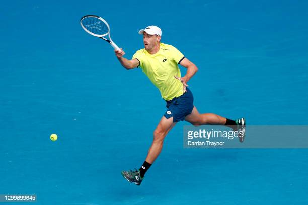 John Millman of Australia plays a forehand in his Group B singles match against Pablo Carreno Busta of Spain during day one of the 2021 ATP Cup at...