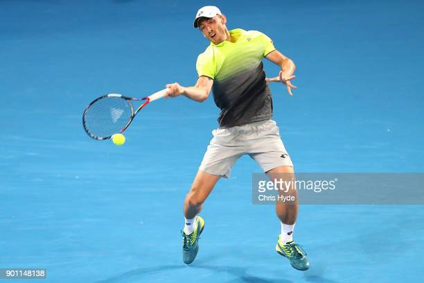 John Millman of Australia plays a forehand in his match against Grigor Dimitrov of Bulgaria during day five of the 2018 Brisbane International at Pat...