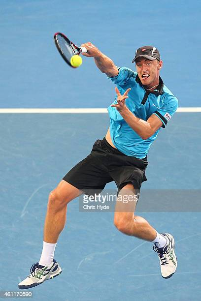 John Millman of Australia plays a forehand in his match against Roger Federer of Switzerland during day five of the 2015 Brisbane International at...