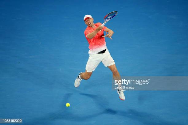 John Millman of Australia plays a forehand in his second round match against Roberto Bautista Agut of Spain during day three of the 2019 Australian...
