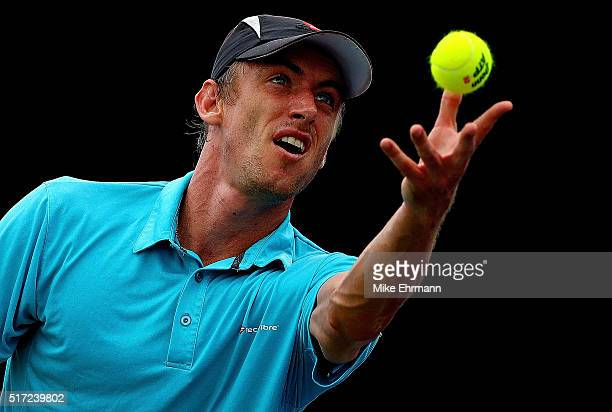 John Millman of Australia plays a match against Pablo Carreno Busta of Spain during Day 4 of the Miami Open presented by Itau at Crandon Park Tennis...