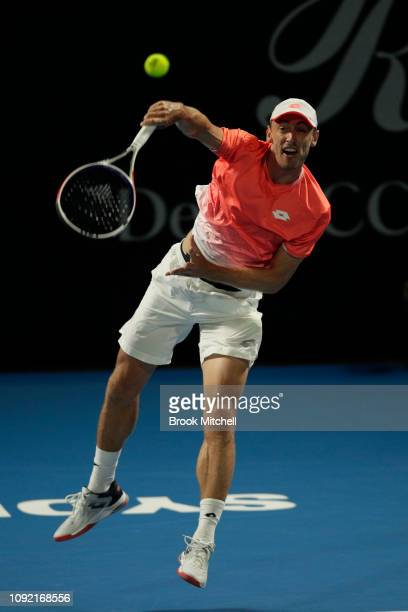 John Millman of Australia plays a stroke during his match with Gilles Simon of France on day five of the 2019 Sydney International at the Sydney...