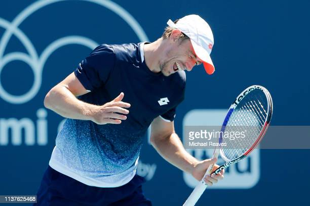 John Millman of Australia reacts during his match against Federico Delbonis of Argentina during Day 5 of the Miami Open Presented by Itau at Hard...
