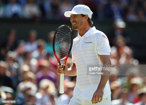 John Millman of Australia reacts during the Men's Singles third round match against Andy Murray of Great Britain on day six of the Wimbledon Lawn...