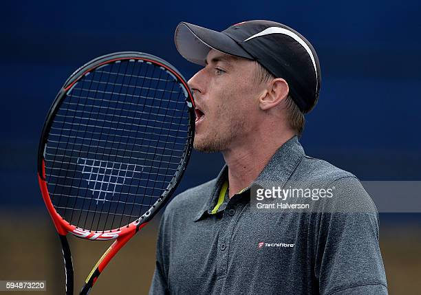 John Millman of Australia reacts in his match against Bjorn Fratangelo of the United States during the WinstonSalem Open at Wake Forest University on...