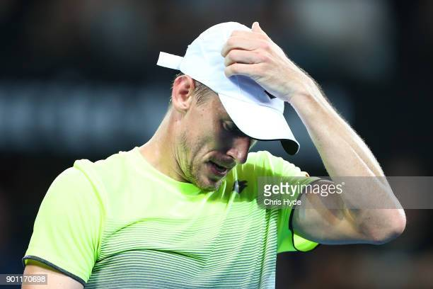 John Millman of Australia reacts in his match against Grigor Dimitrov of Bulgaria during day five of the 2018 Brisbane International at Pat Rafter...