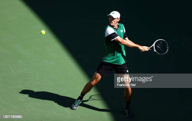John Millman of Australia returns a backhand during the Round of 64 Men's Single's match between Bernabe Zapata Miralles and John Millman on Day Nine...