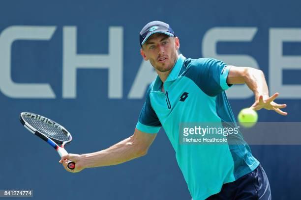 John Millman of Australia returns a shot against Malek Jaziri of Tunisia during their second round Men's Singles match on Day Four of the 2017 US...