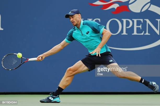 John Millman of Australia returns a shot against Philipp Kohlschreiber of Germany during their Men's Singles third round match on Day Six of the 2017...