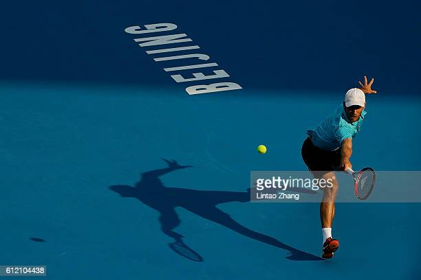 John Millman of Australia returns a shot against Roberto Bautista Agut of Spain during the Men's singles first round match on day three of the 2016...