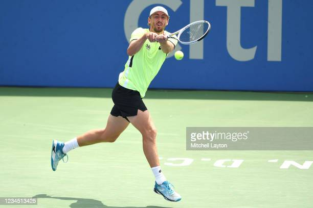 John Millman of Australia returns a shot during a quarter final match against Jenson Booksby of the United States on Day 7 during the Citi Open at...