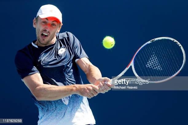 John Millman of Australia returns a shot to Federico Delbonis of Argentina during Day 5 of the Miami Open Presented by Itau at Hard Rock Stadium on...