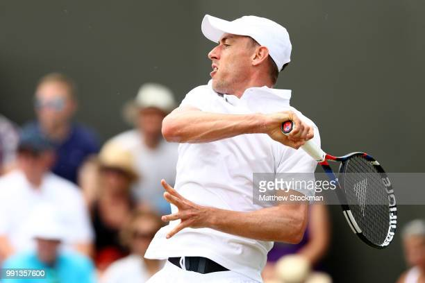 John Millman of Australia returns against Milos Raonic of Canada during their Men's Singles second round match on day three of the Wimbledon Lawn...