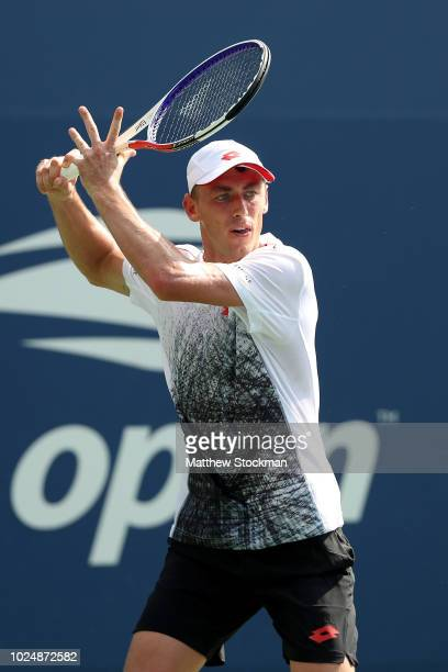 John Millman of Australia returns the ball during his men's singles first round match against Jenson Brooksby of the United States on Day Two of the...