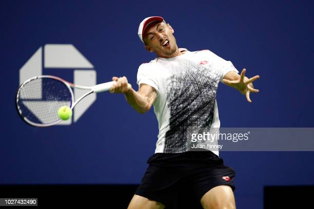 John Millman of Australia returns the ball during his men's singles quarterfinal match against Novak Djokovic of Serbia on Day Ten of the 2018 US...
