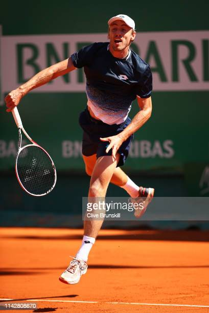 John Millman of Australia serves against Roberto Bautista Agut of Spain in their first round match during day two of the Rolex MonteCarlo Masters at...