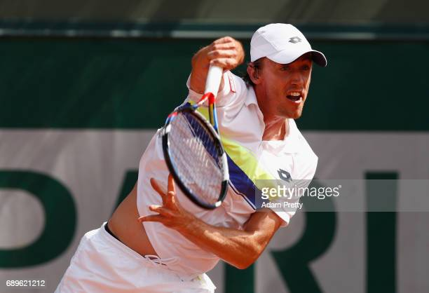 John Millman of Australia serves during the mens singles first round match against Roberto Bautista Agut of Spain on day two of the 2017 French Open...