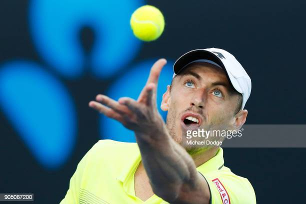 John Millman of Australia serves in his first round match against Borna Coric of Croatia on day one of the 2018 Australian Open at Melbourne Park on...