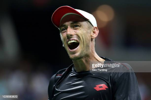 John Millman of Australia shows his emotions during the men's singles fourth round match against Roger Federer of Switzerland on Day Eight of the...