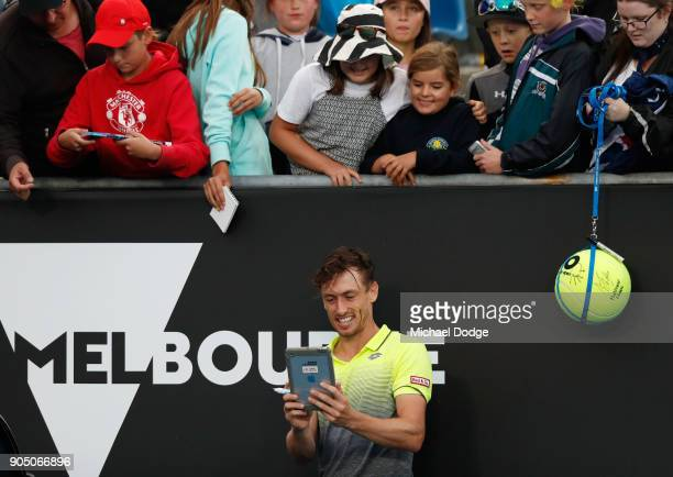 John Millman of Australia takes a selfie with fans after winning his first round match against Borna Coric of Croatia on day one of the 2018...