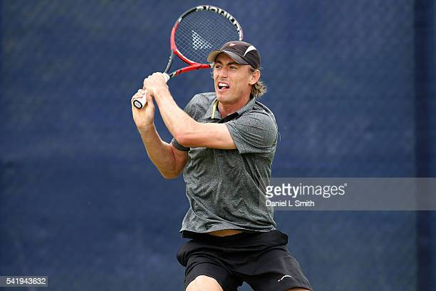 John Millman of Austrlia plays a backhand during his men's singles match against Steve Johnson of USA during day two of the ATP Aegon Open Nottingham...