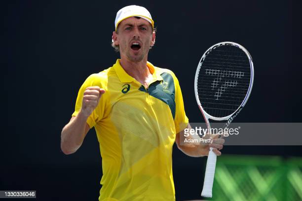 John Millman of Team Australia celebrates after a point during his Men's Singles First Round match against Lorenzo Musetti of Team Italy on day one...