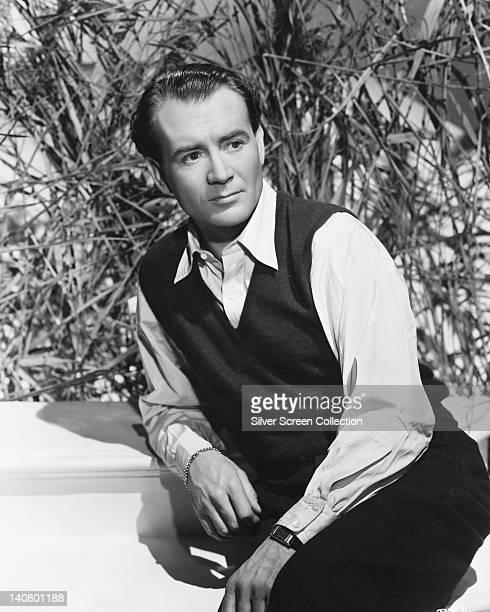 John Mills British actor wearing a black tank top over a white shirt circa 1940