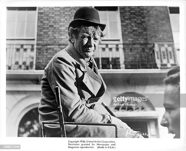 John Mills looking down towards the street in a scene from the film 'Around The World In Eighty Days' 1956