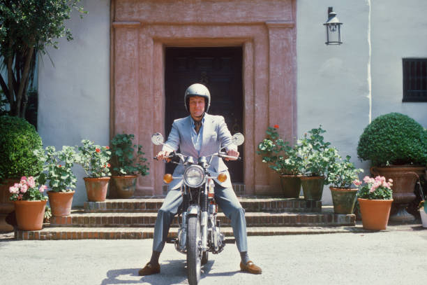 John Mitchell astride a motorcycle, Santa Barbara,...