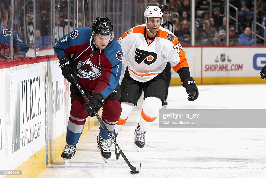 John Mitchell #7 of the Colorado Avalanche brings the puck down the ice against the Philadelphia Flyers at the Pepsi Center on December 14, 2016 in Denver, Colorado.