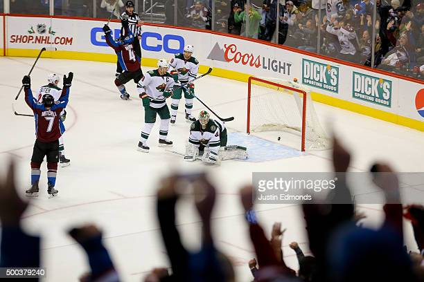 John Mitchell of the Colorado Avalanche celebrates his gamewinning goal against goaltender Darcy Kuemper of the Minnesota Wild during overtime at...
