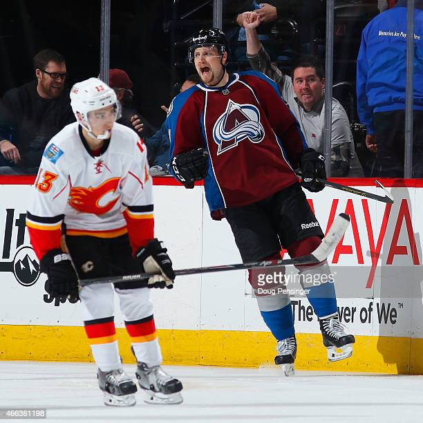 John Mitchell of the Colorado Avalanche celebrates his goal as Johnny Gaudreau of the Calgary Flames skates away to give the Avs a 31 lead in the...