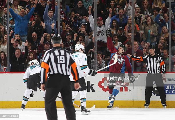 John Mitchell of the Colorado Avalanche celebrates scoring a second period goal as members of the San Jose Sharks react at the Pepsi Center on March...