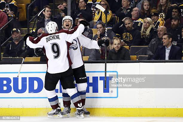 John Mitchell of the Colorado Avalanche celebrates with Matt Duchene after scoring against the Boston Bruins during the first period at TD Garden on...
