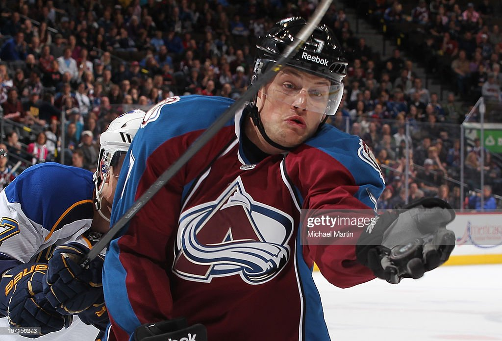 John Mitchell #7 of the Colorado Avalanche grabs the puck out of the air against the St Louis Blues at the Pepsi Center on April 21, 2013 in Denver, Colorado. The Avalanche defeated the Blues 5-3.