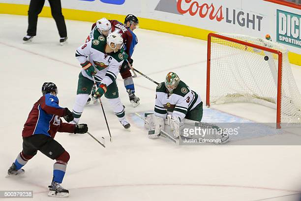 John Mitchell of the Colorado Avalanche shoots and scores the gamewinning goal past Darcy Kuemper of the Minnesota Wild during overtime at Pepsi...