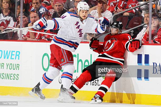 John Mitchell of the New York Rangers checks Petr Sykora of the New Jersey Devils in the second period of Game Three of the Eastern Conference Final...