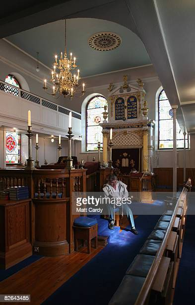 John Mitchell president of the Plymouth Hebrew Congregation reads his prayer book inside the Plymouth Synagogue as it opens its doors to promote...