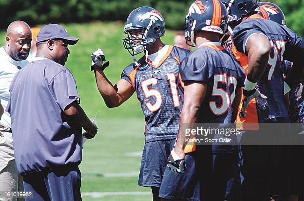 John Mobley talks with coaches during practice drills at the Broncos minicamp at the Dove Valley facility